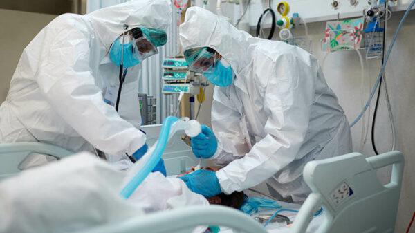 Doctors inserting ventilator