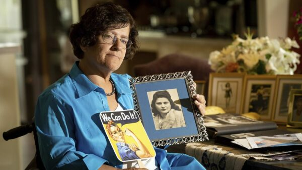 Dorene holding a photo of her mother Primetta